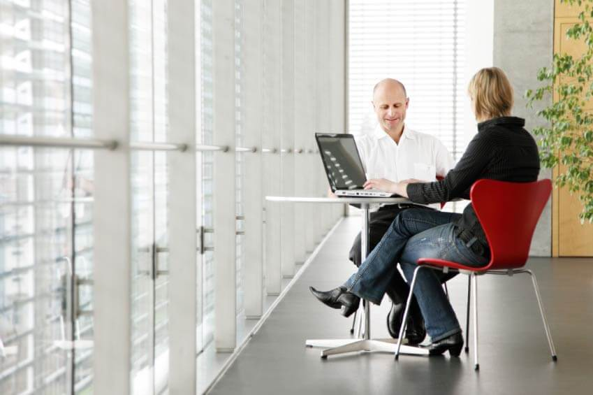 What is the difference between a business mentor or coach
